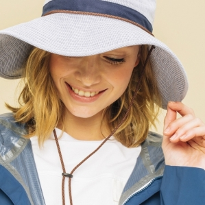 It is feminine in stripe pattern that is refreshing by mannish safari hat design